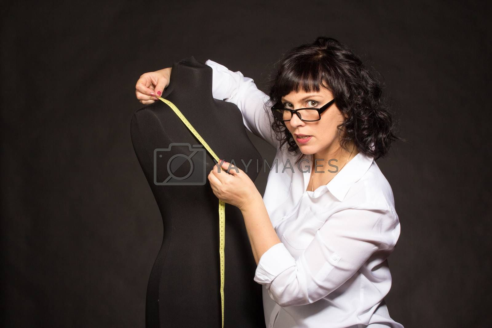 Royalty free image of Adult tailor with mannequin by gsdonlin