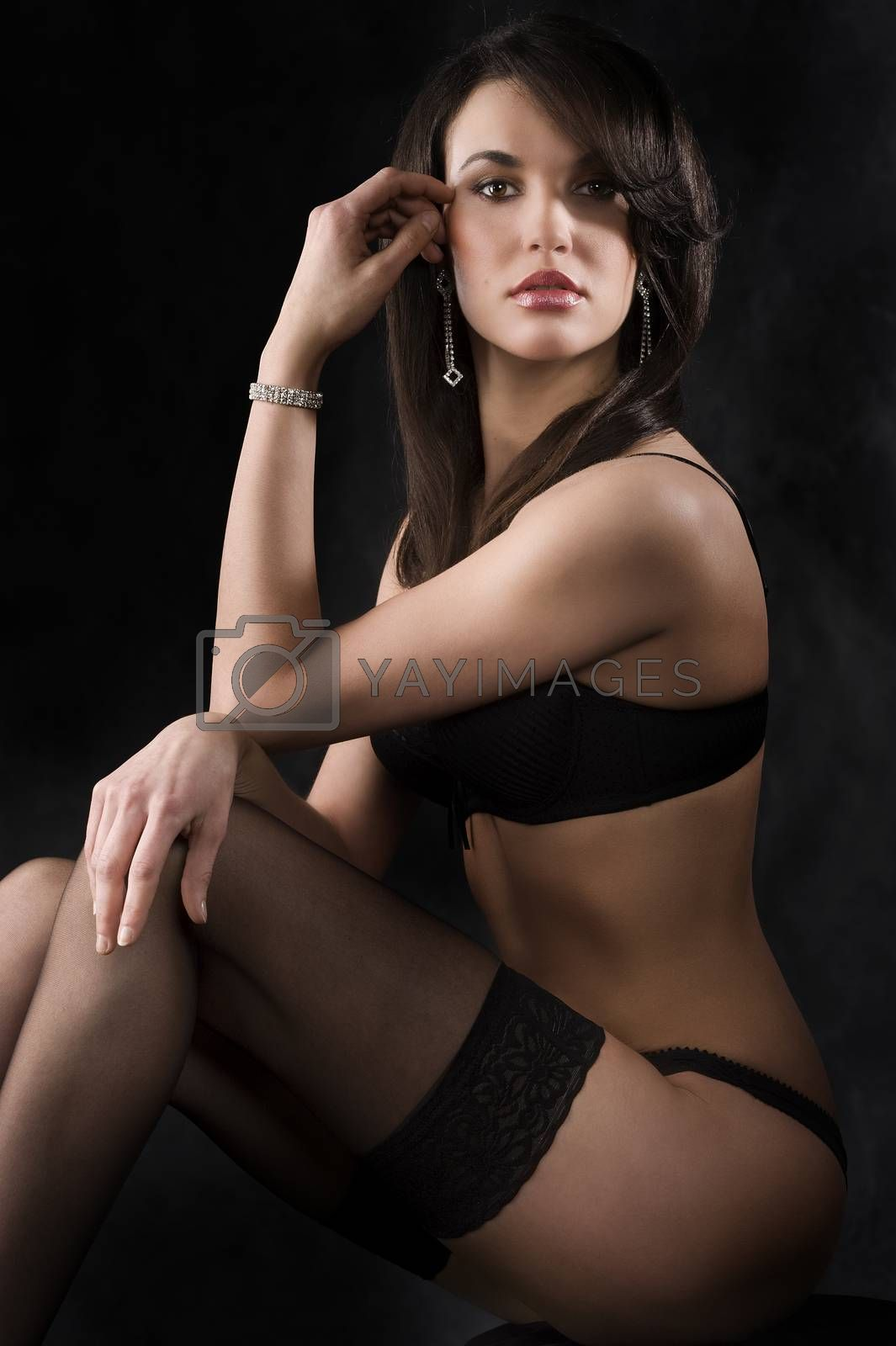 Royalty free image of sexy woman in black by fotoCD