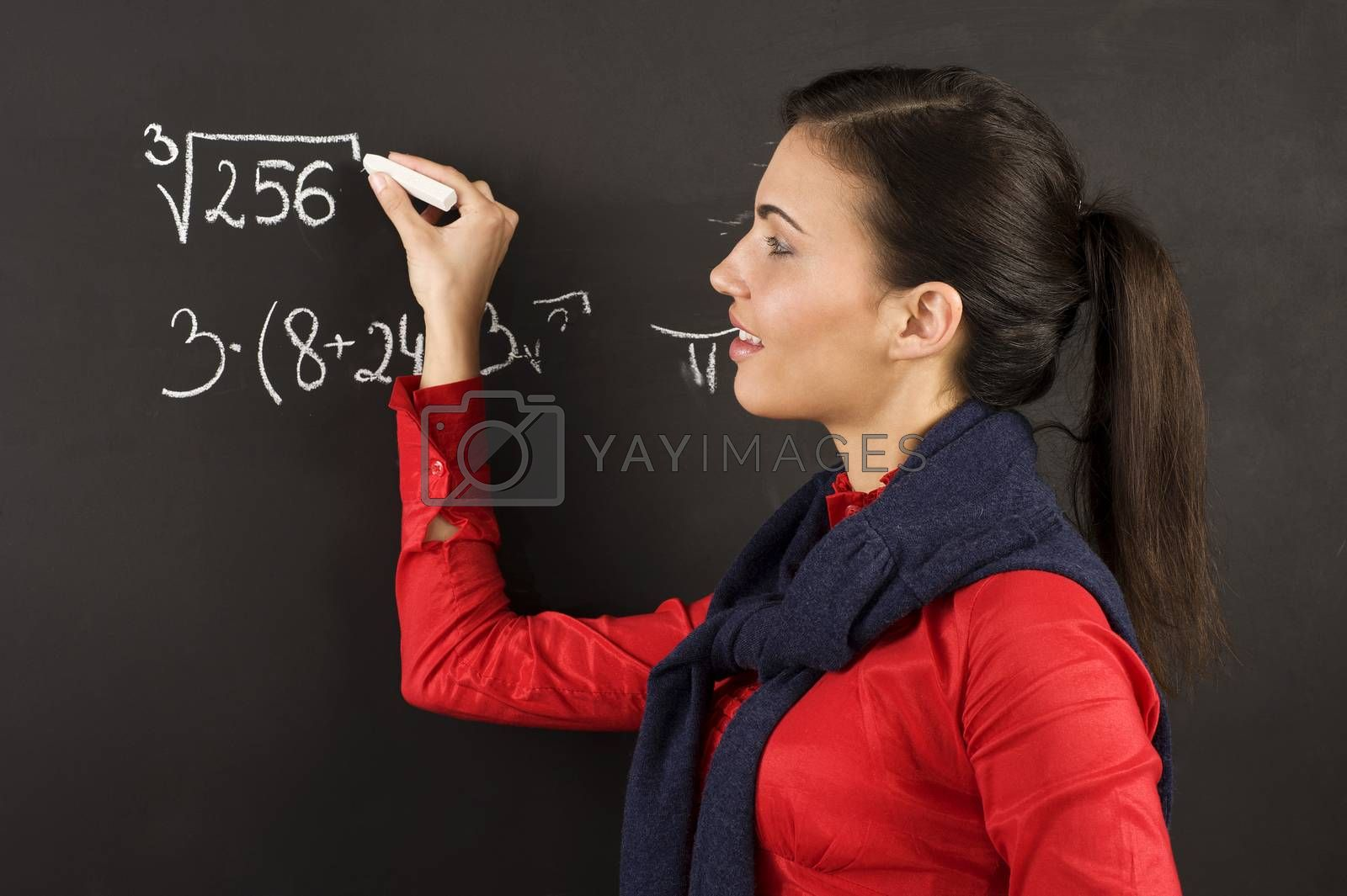 Royalty free image of girl at blackboard by fotoCD