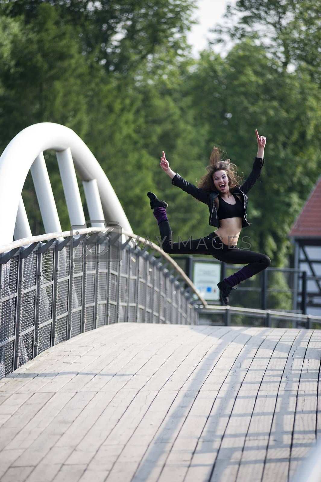 Royalty free image of woman happy and jumping by fotoCD