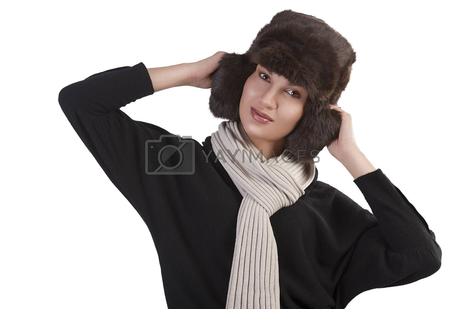 Royalty free image of girl with fur hat and with scarf with fun pose by fotoCD