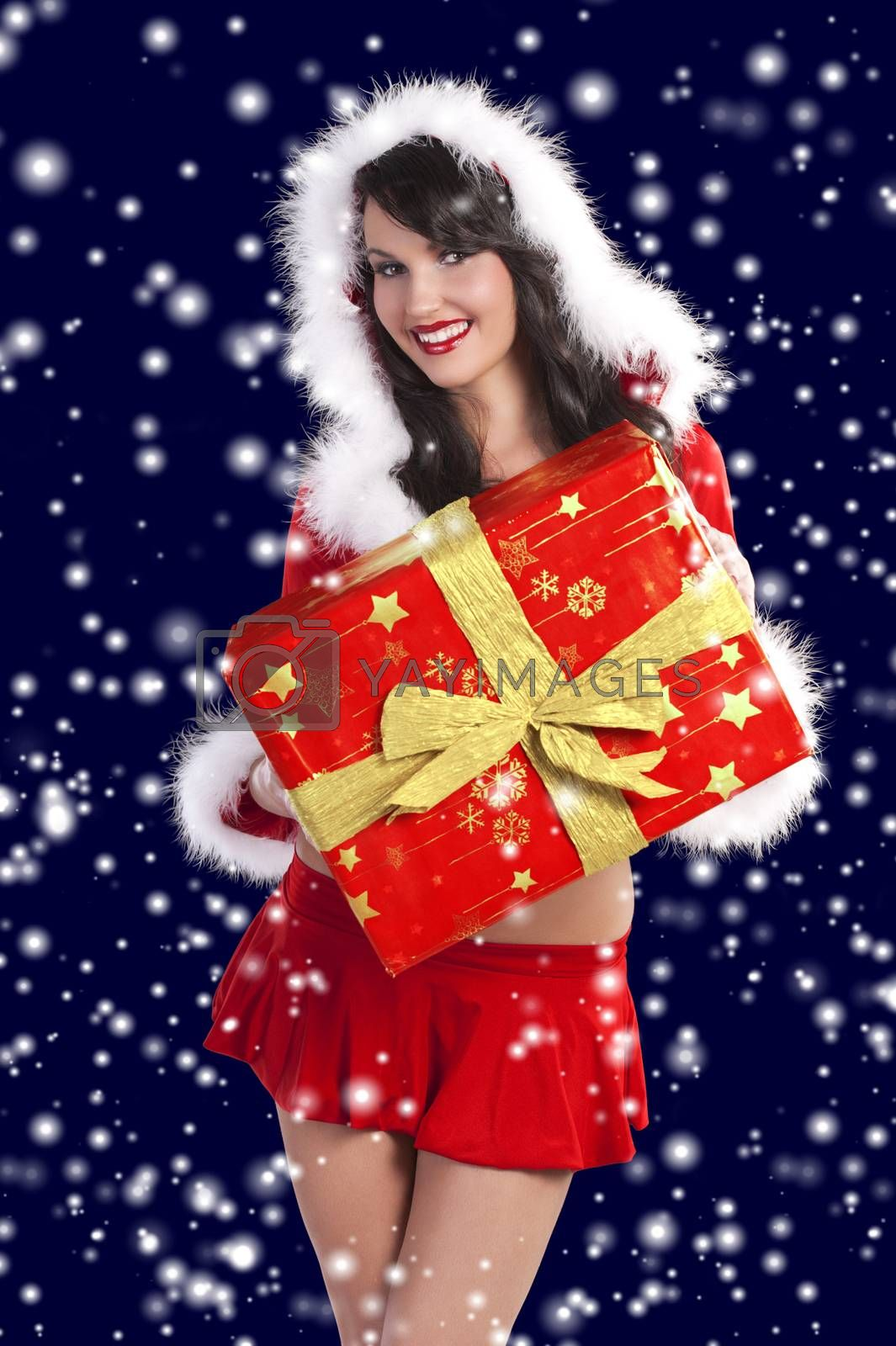 Royalty free image of brunette as santa claus in sow by fotoCD