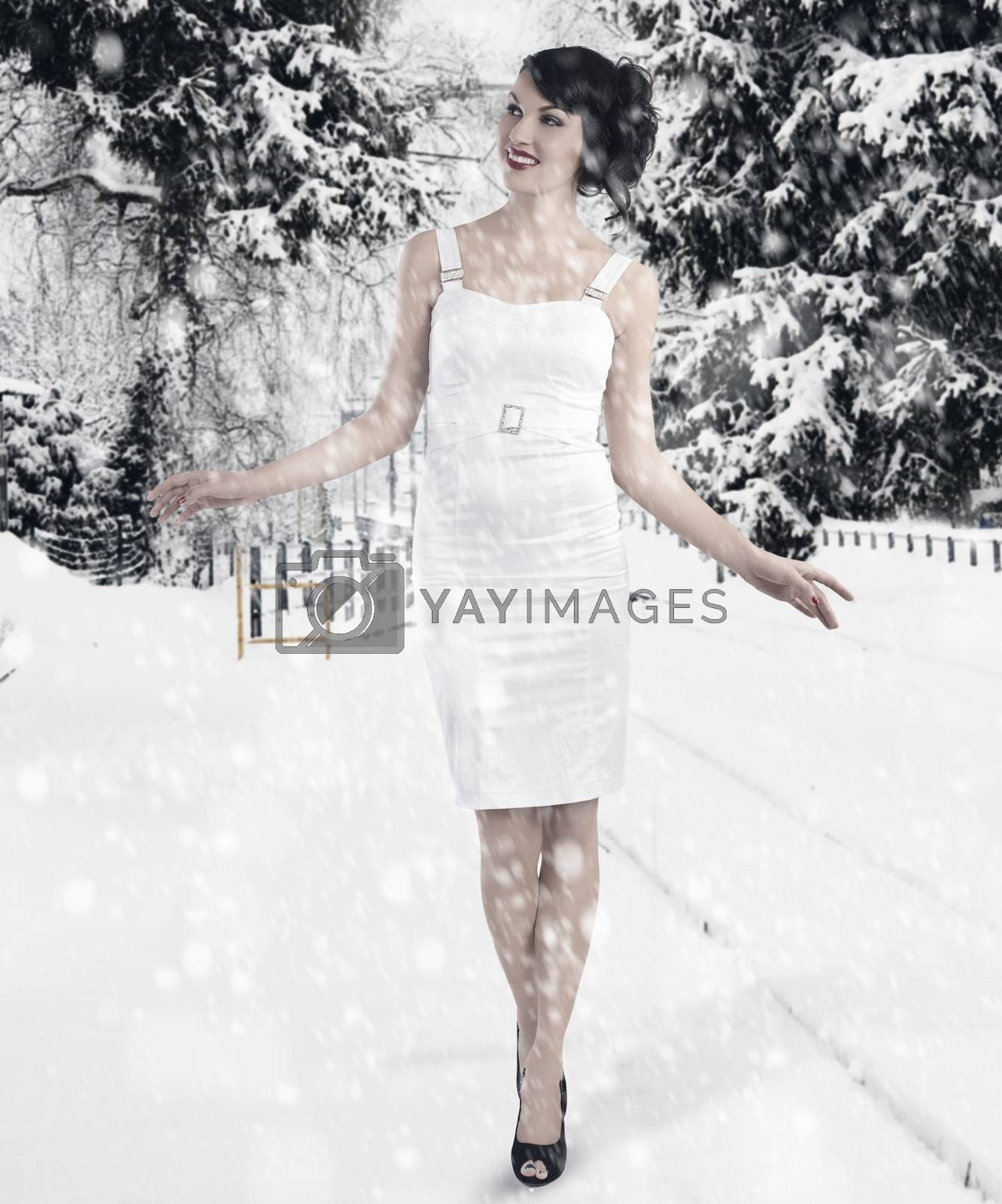Royalty free image of preety girl between the christmas ball by fotoCD