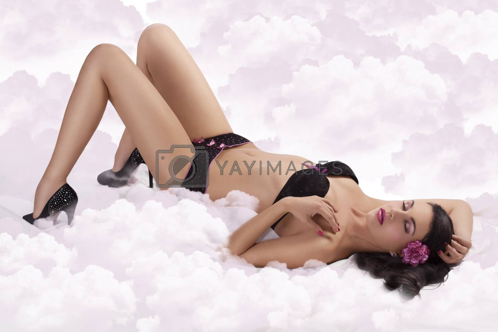 Royalty free image of sensual girl in lingerie with heels laying by fotoCD