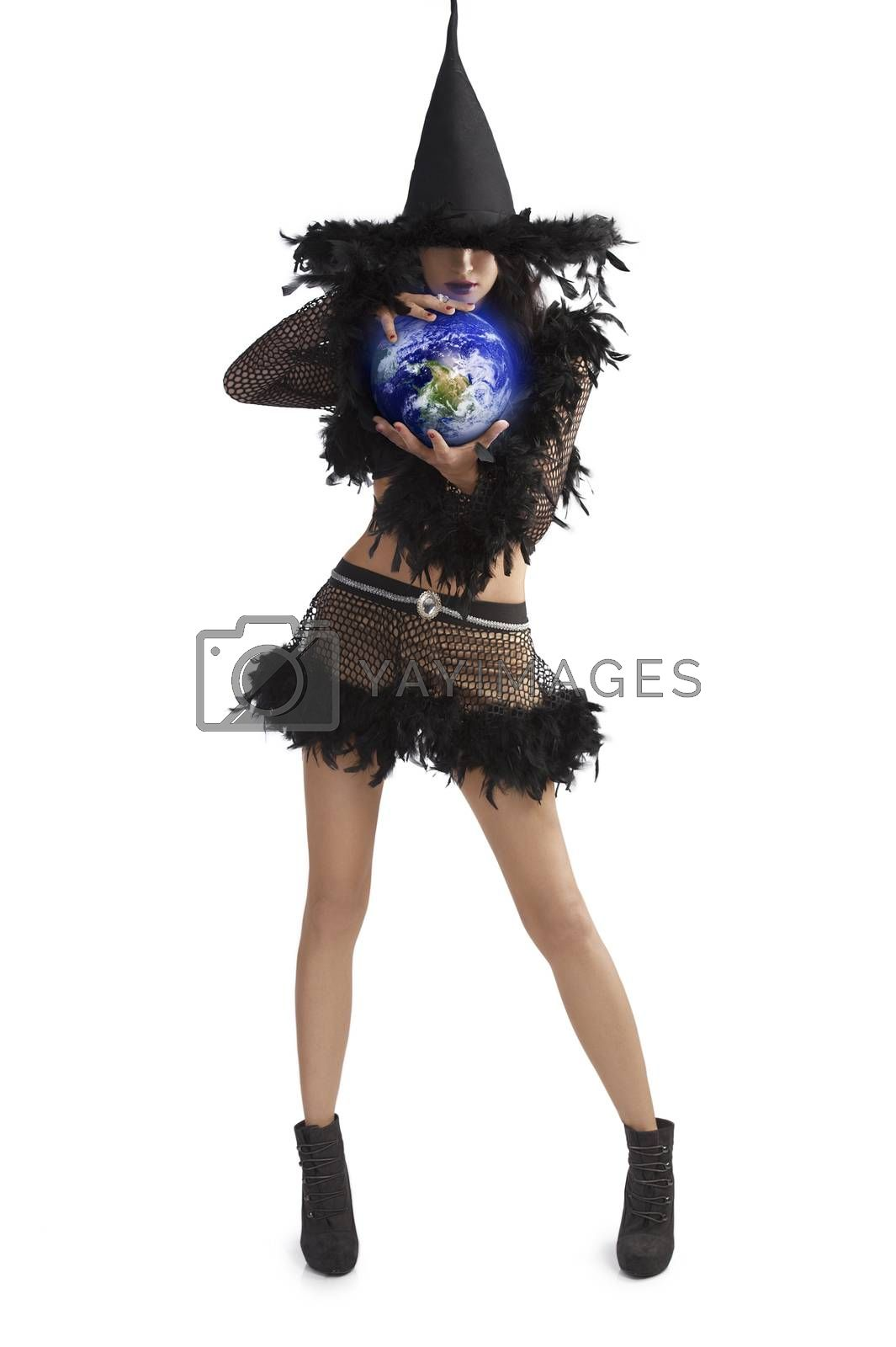 Royalty free image of girl in halloween dress holding world ball by fotoCD