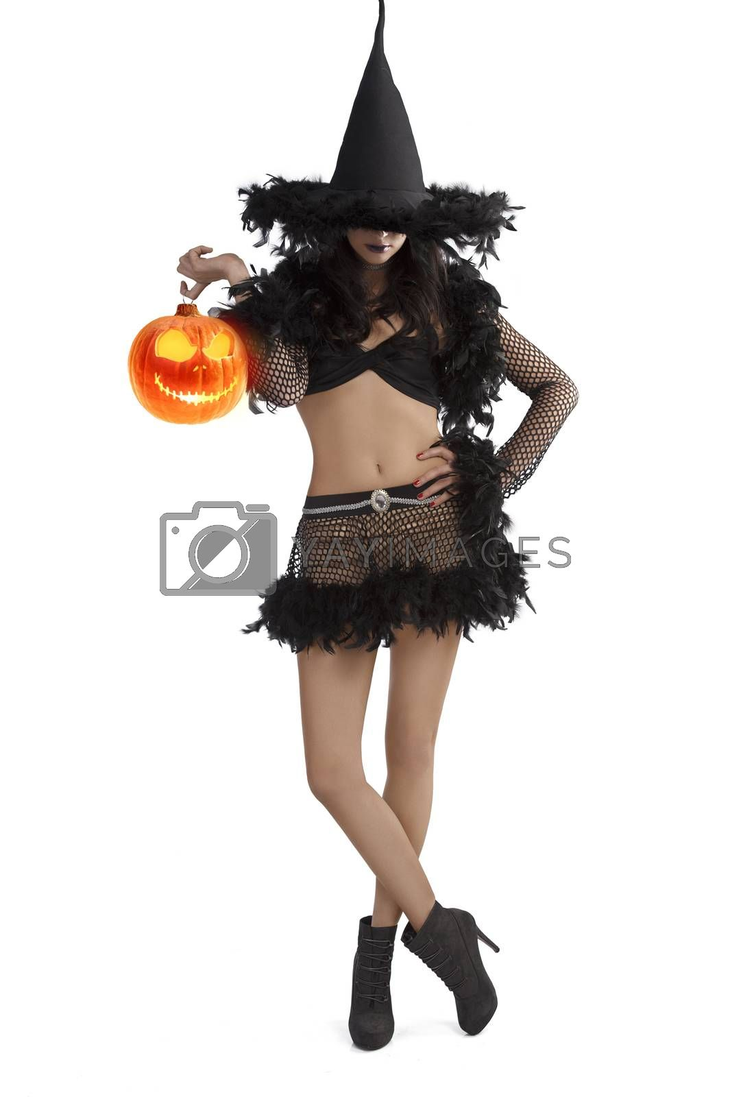 Royalty free image of girl in halloween dress standing with party ball by fotoCD