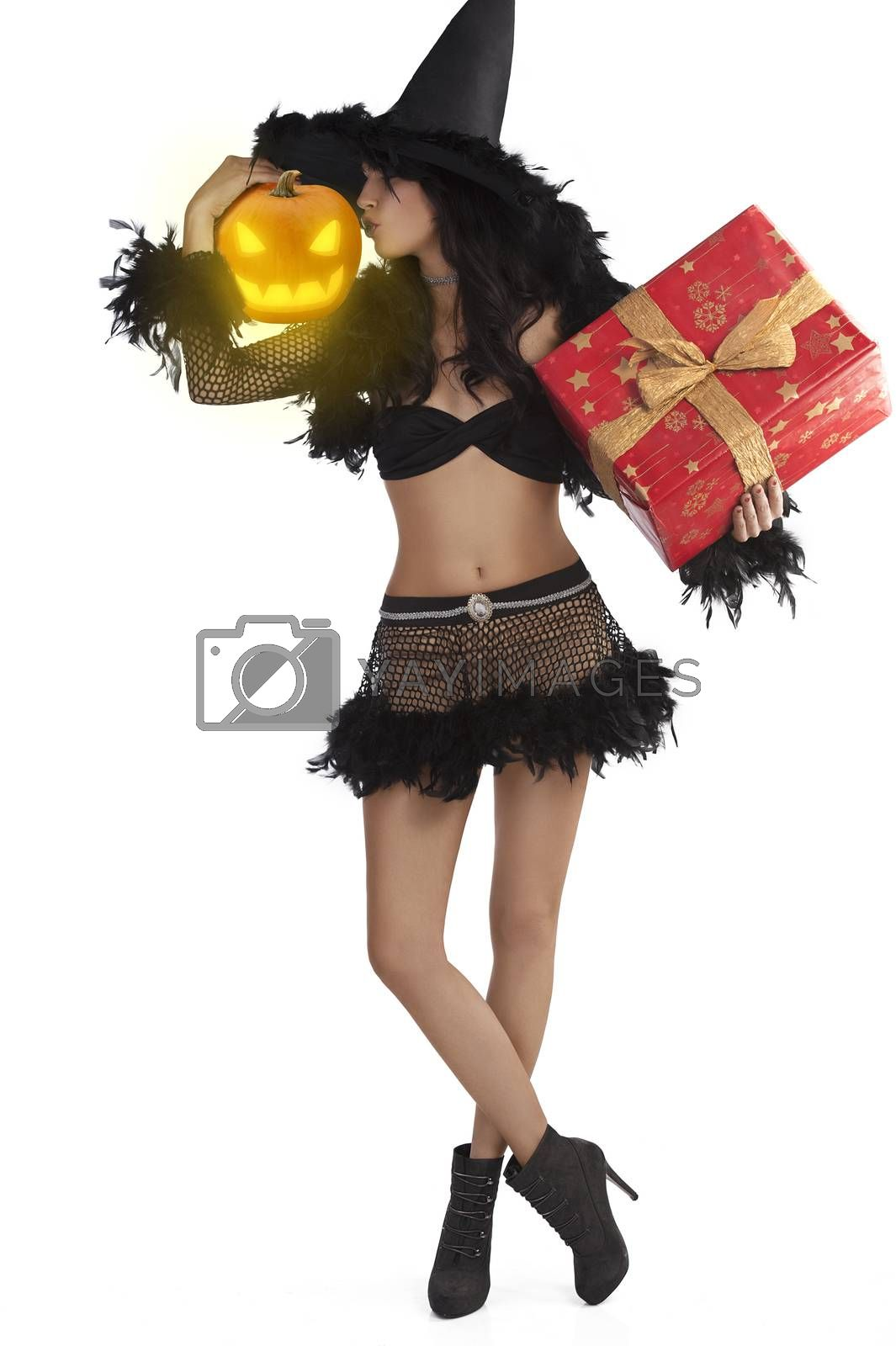 Royalty free image of girl in halloween dress standing with gift box jack-o'-lantern by fotoCD