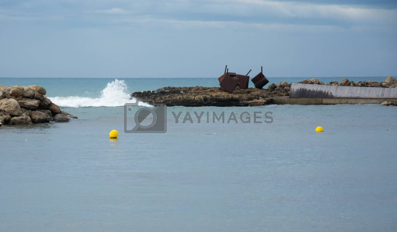 Royalty free image of Two yellow buoys white wave and horizon by ArtesiaWells