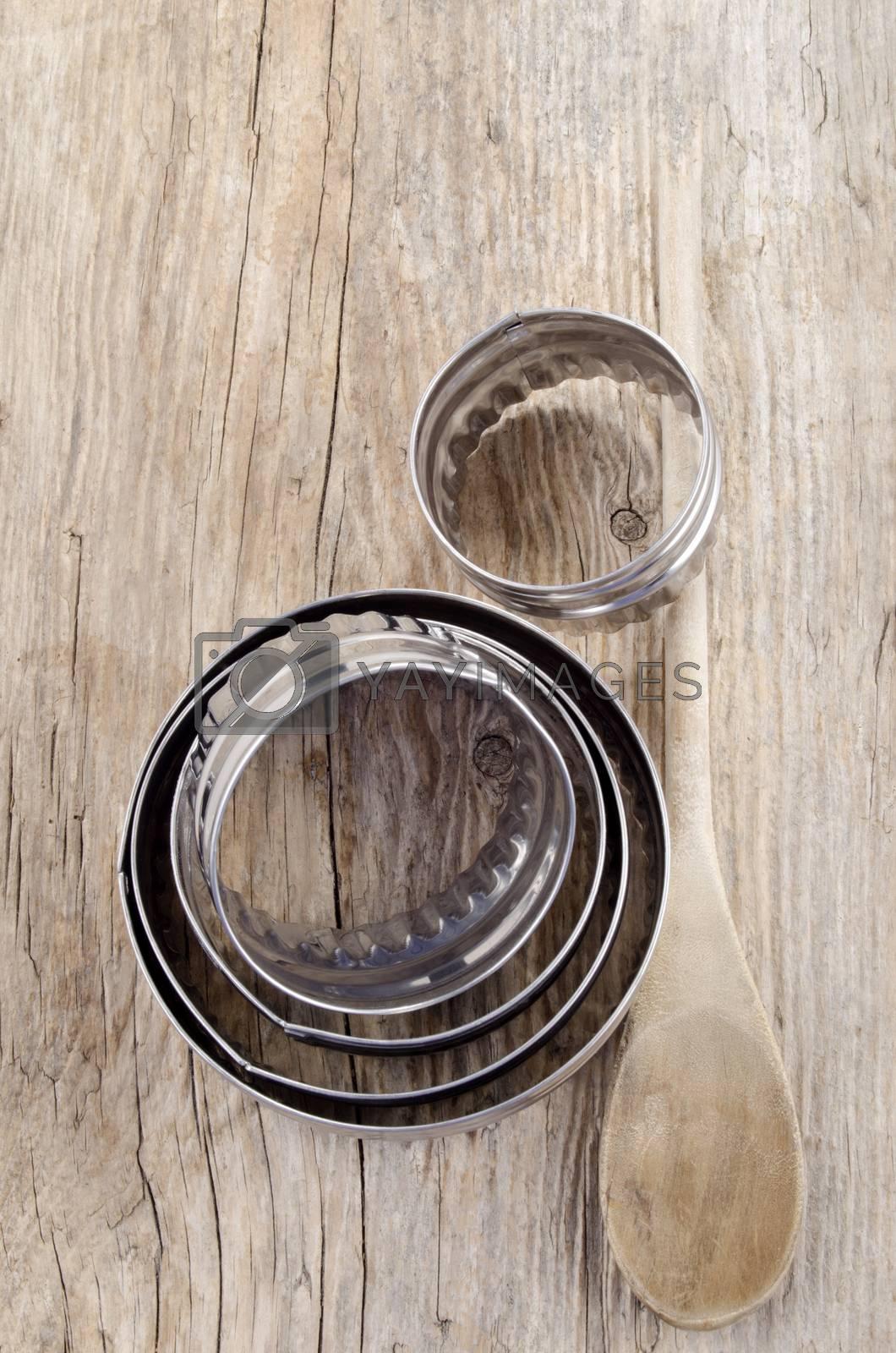 Royalty free image of used baking utensils on wood by Szakaly