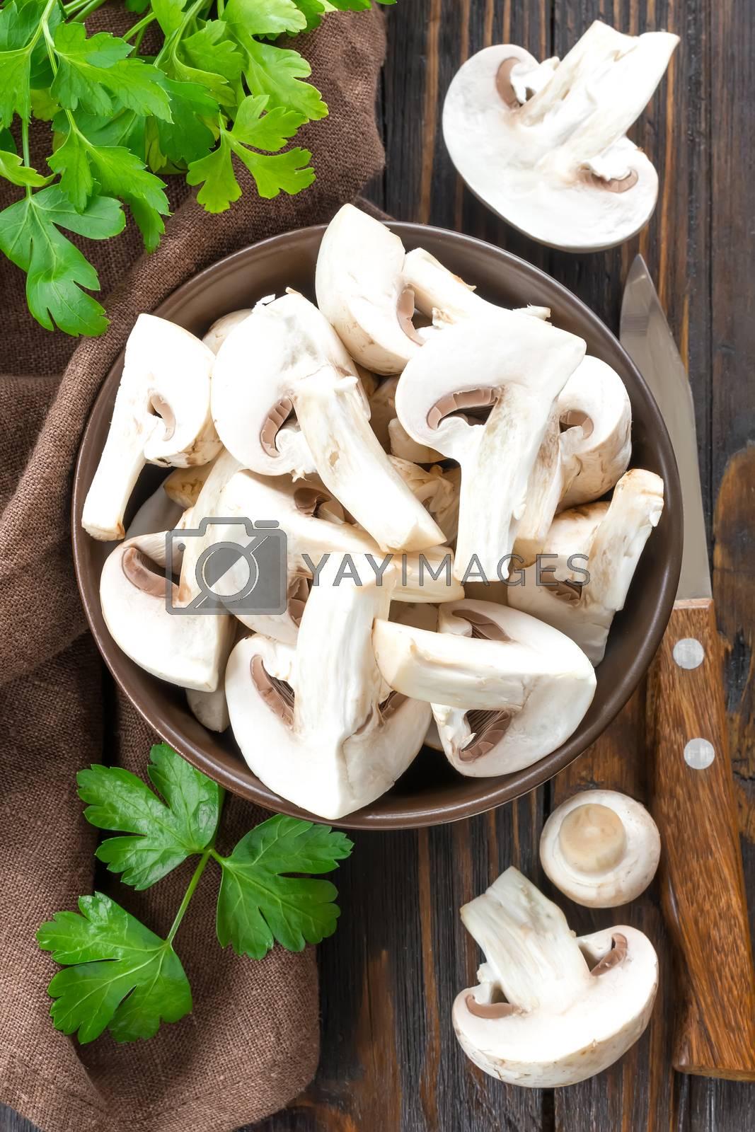 Royalty free image of Raw mushrooms by yelenayemchuk