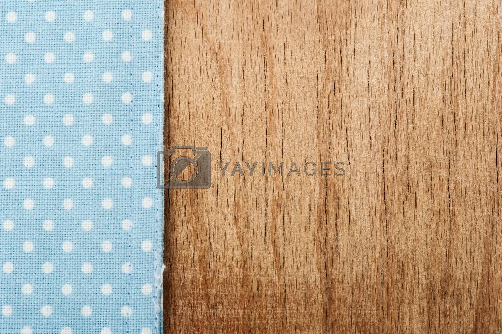Background from tablecloth and wooden table. Vintage style