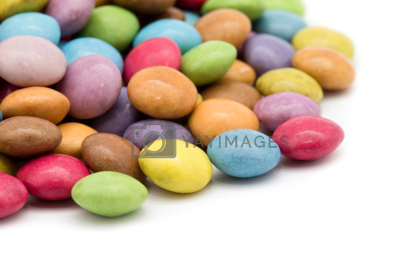 sweet dragees of different color on white background