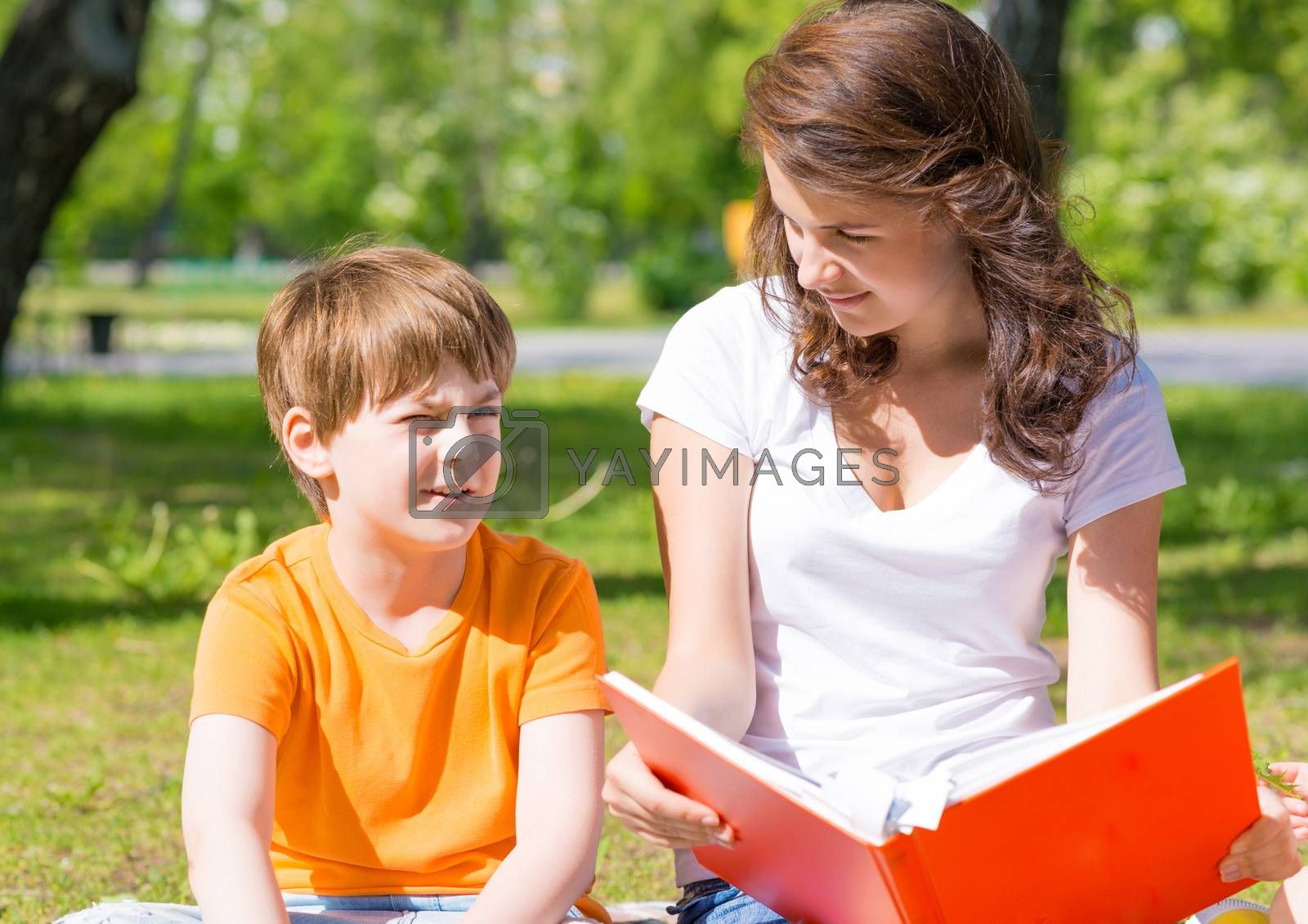 Royalty free image of reading a book together by adam121