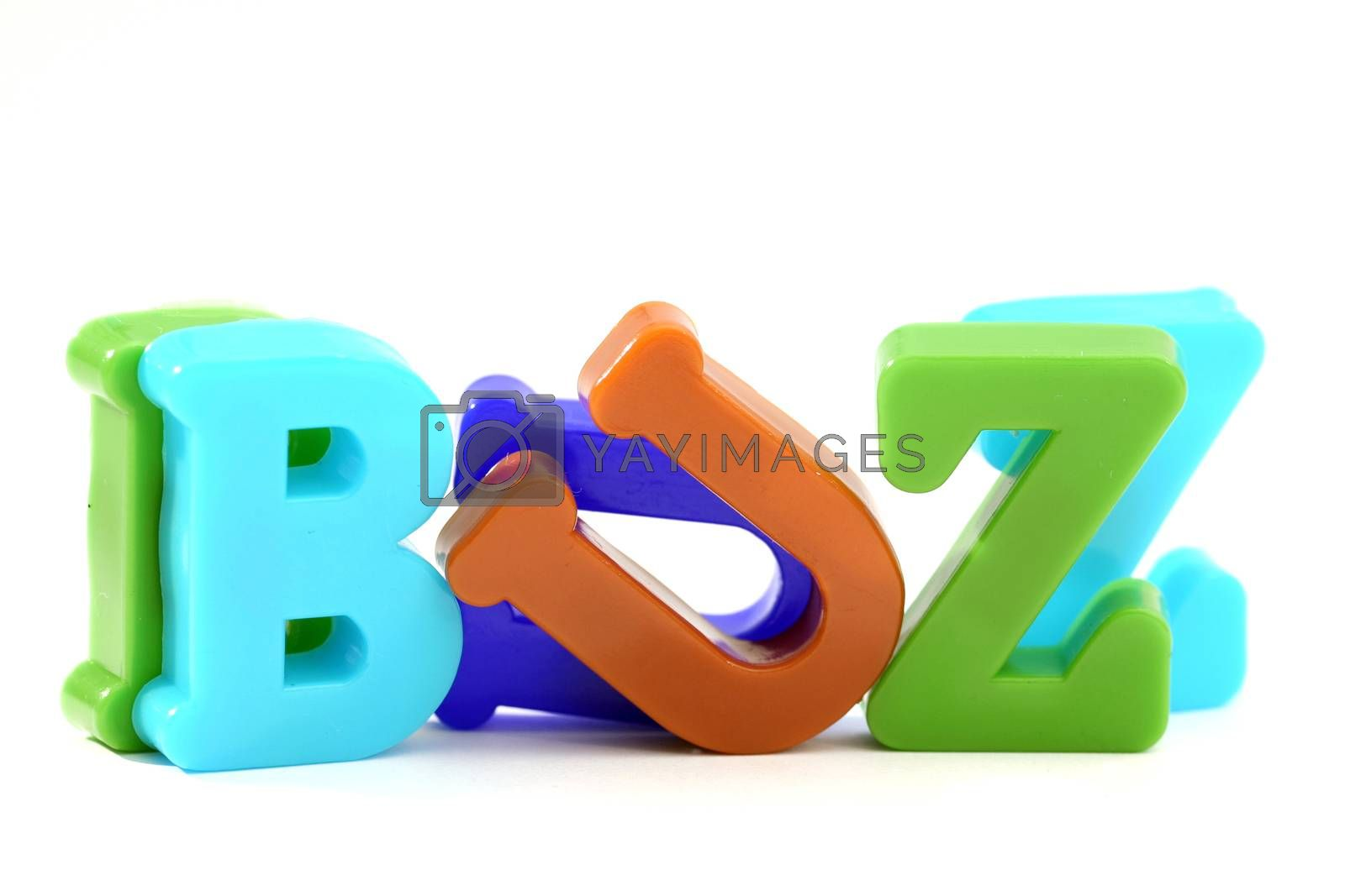 """Close-up of letters. """"Buzz"""" word."""