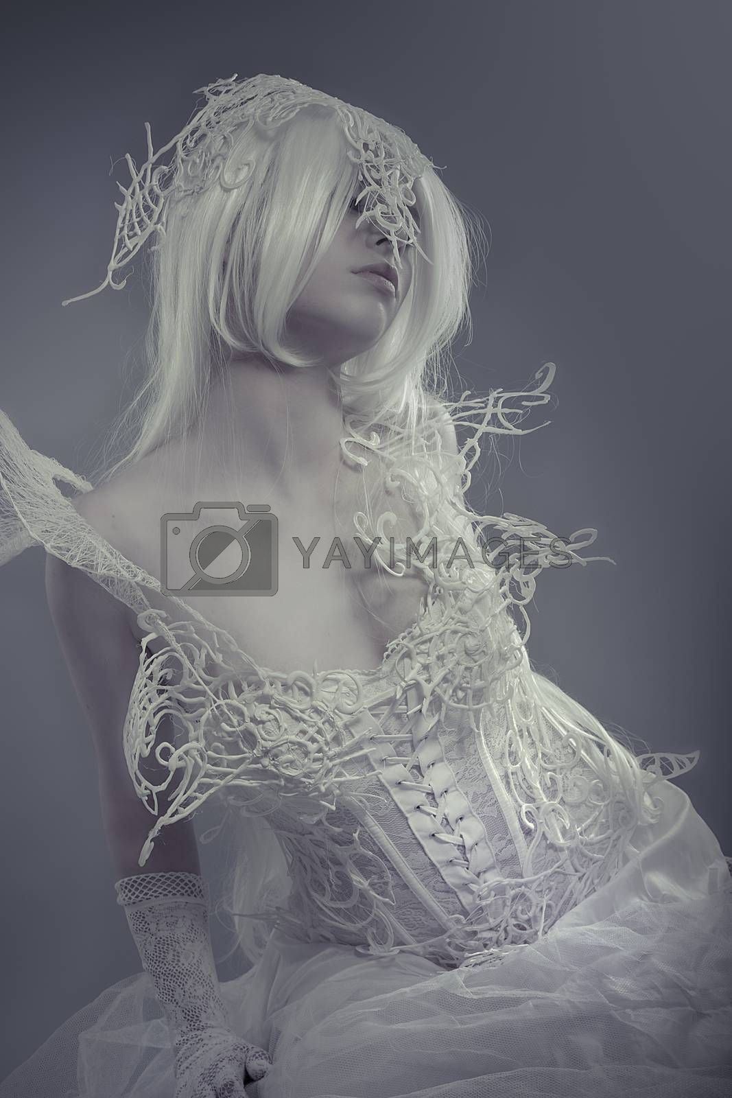 Fantasy. Beautiful model with long white hair and vintage corset