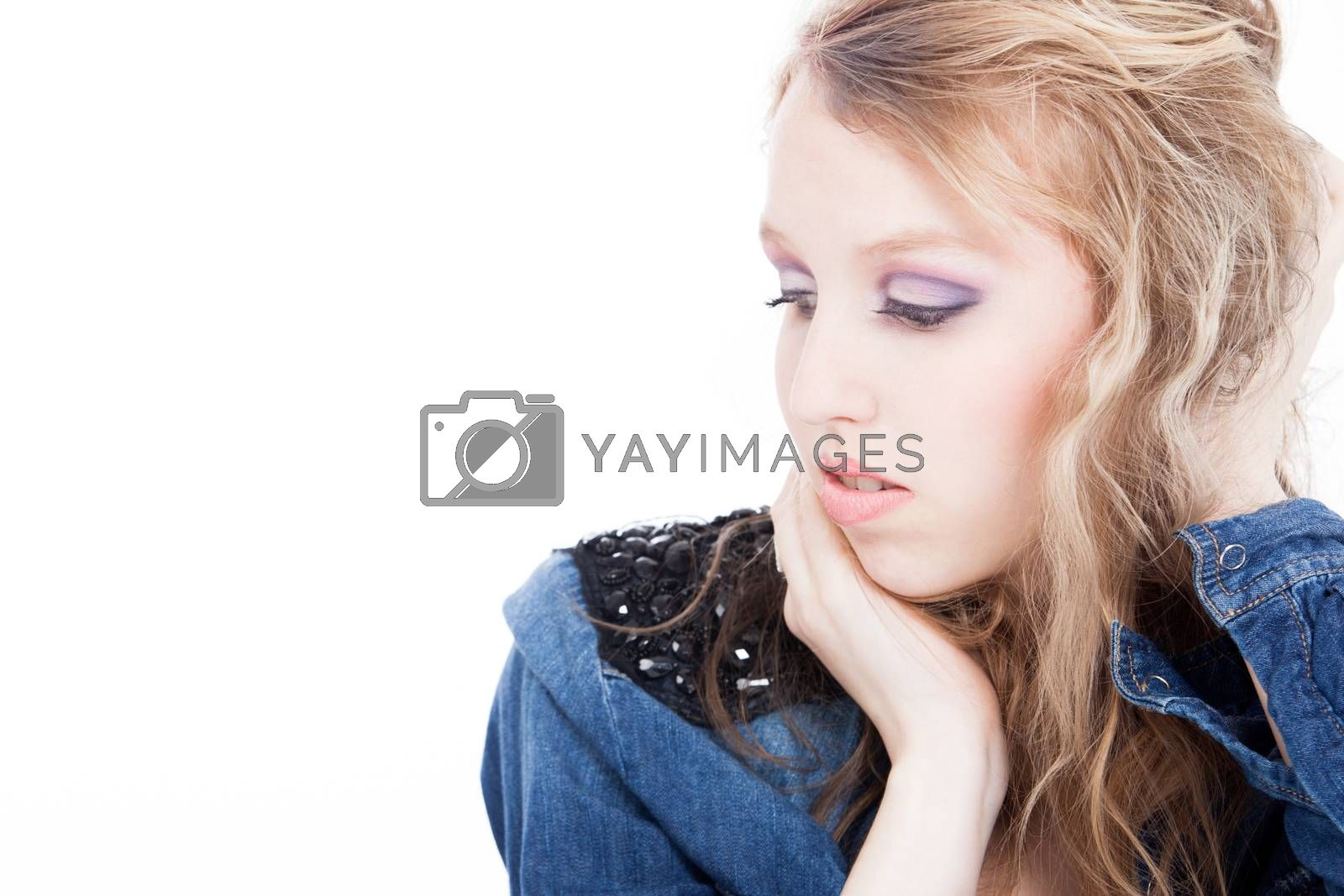 Young tough blond teenage girl with jeans blouse on a white background
