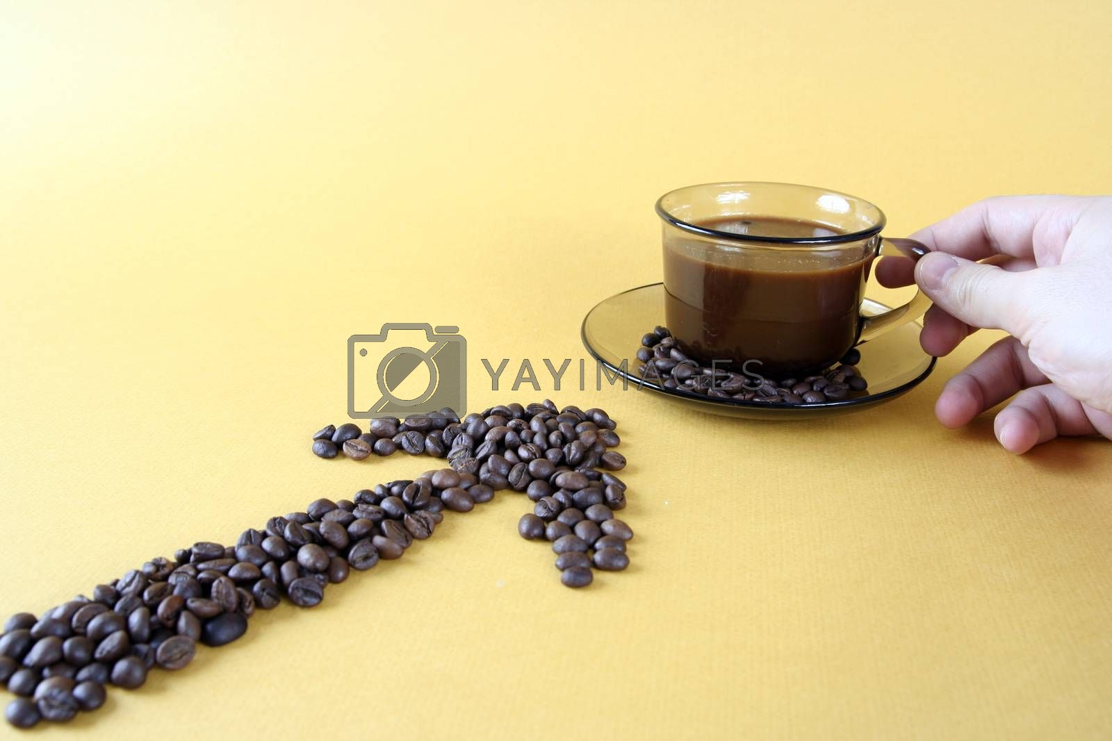 Cup with coffee, costing on coffee grain.