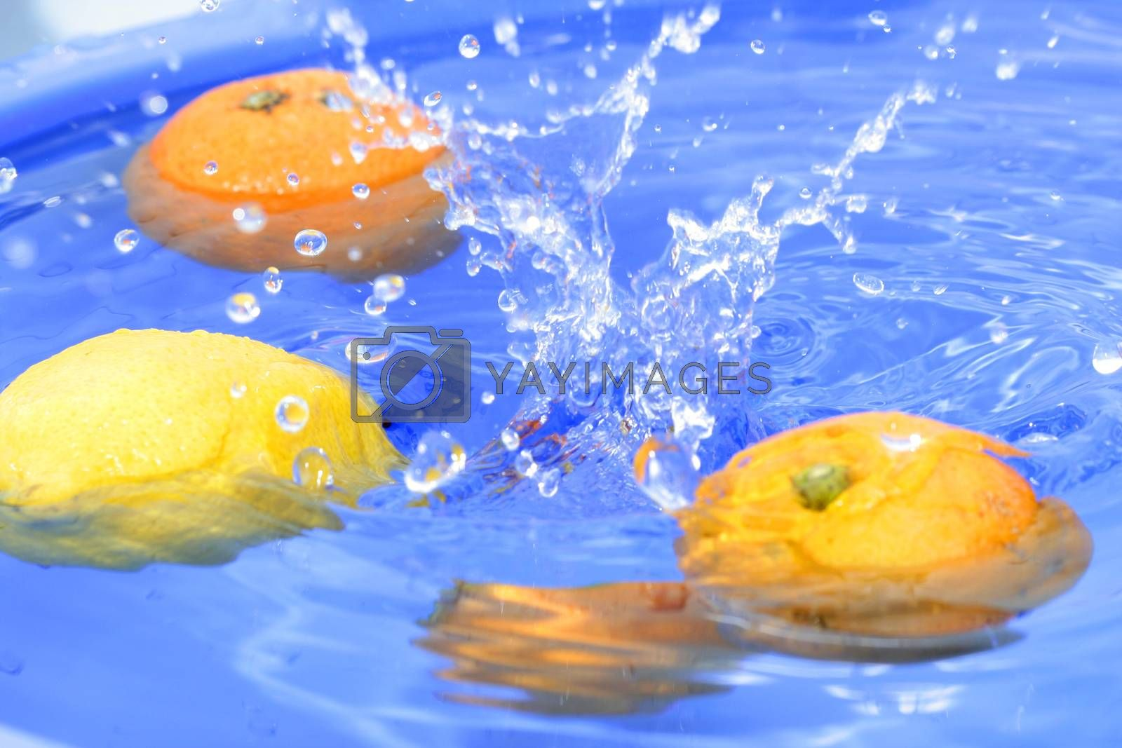 Oranges and lemons in water
