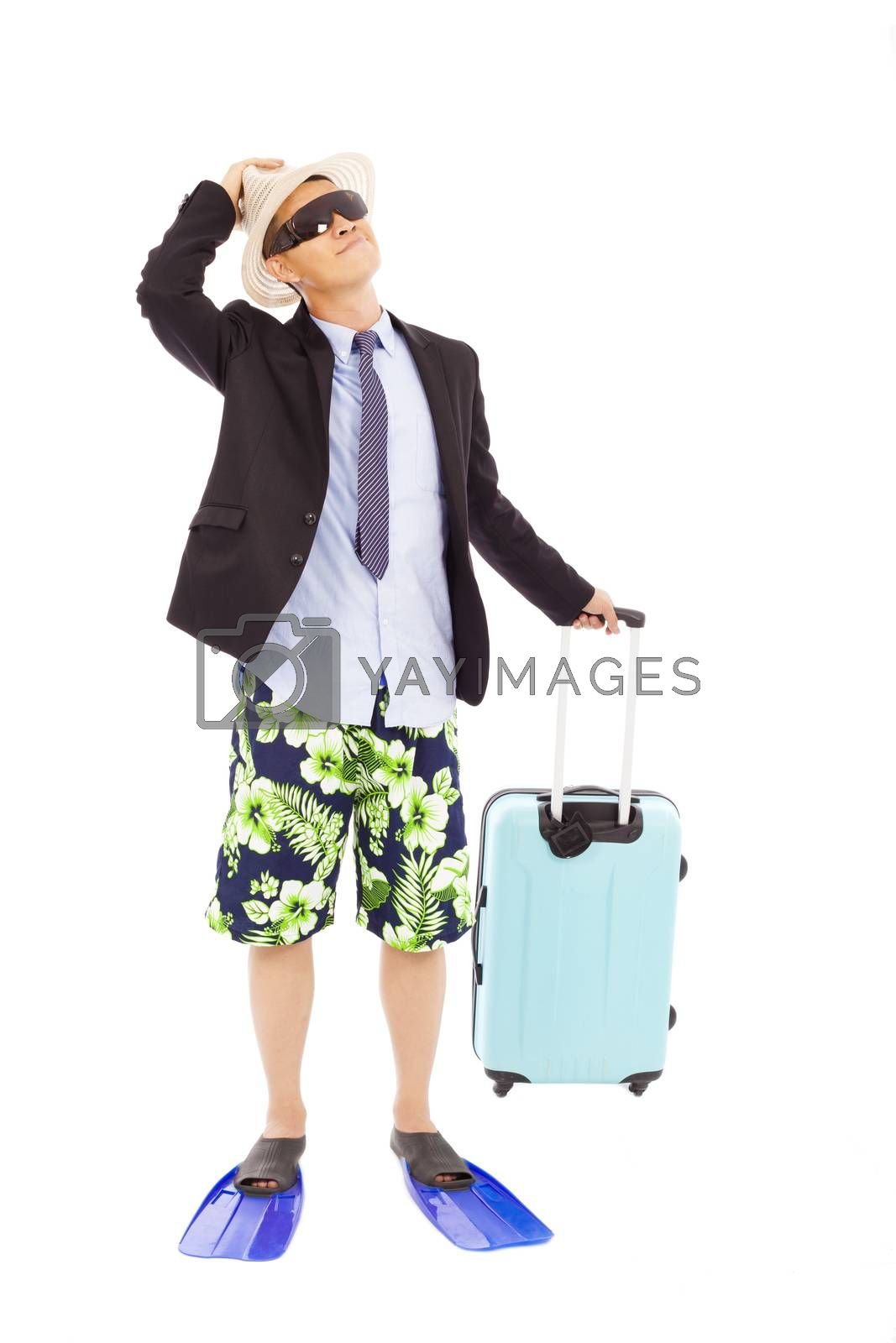 Royalty free image of businessman holding a baggage and look up by tomwang