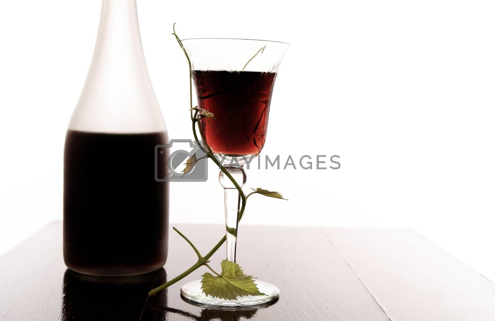 red wine glass and bottle isolated on white