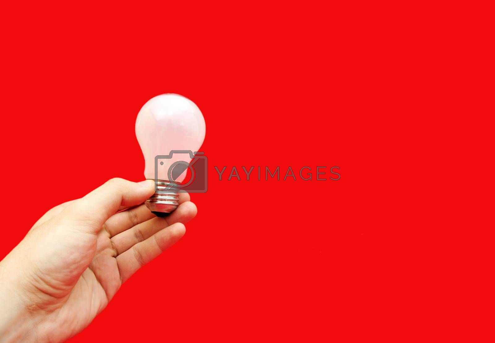 Background with lit lightbulb. Isolated on red