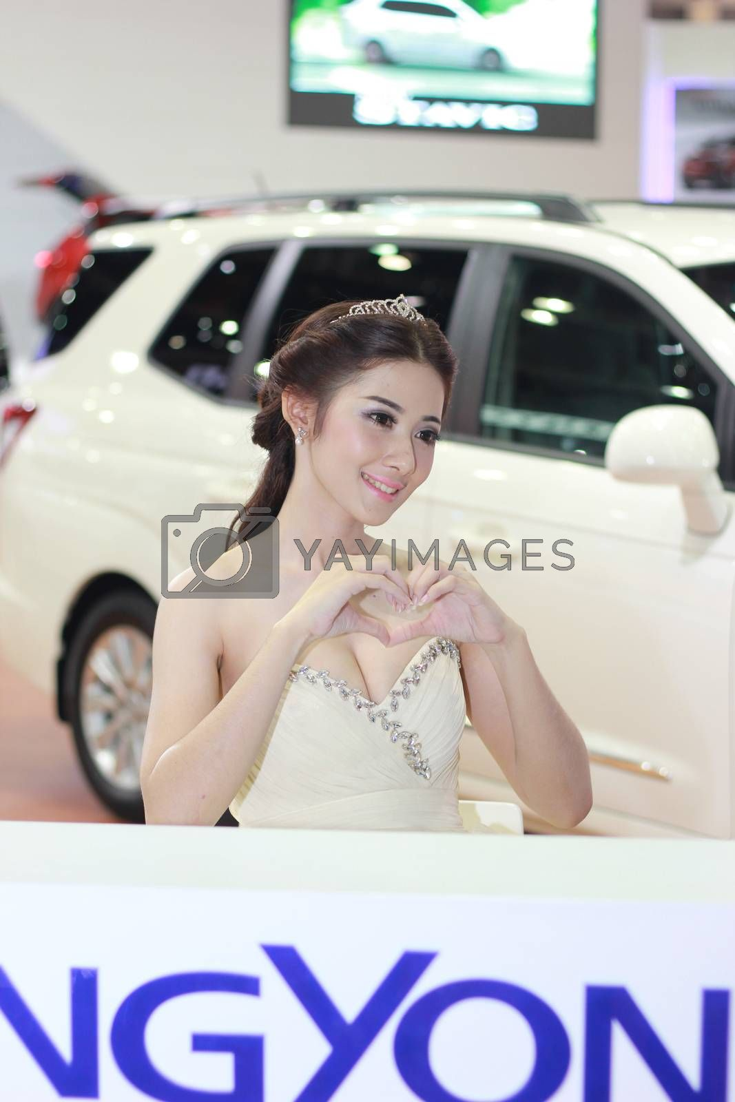 BANGKOK, THAILAND - MARCH 30, 2014: Unidentified female presenter pose in the 35th Bangkok International Motor Show on March 30, 2014 in Nonthaburi, Thailand.