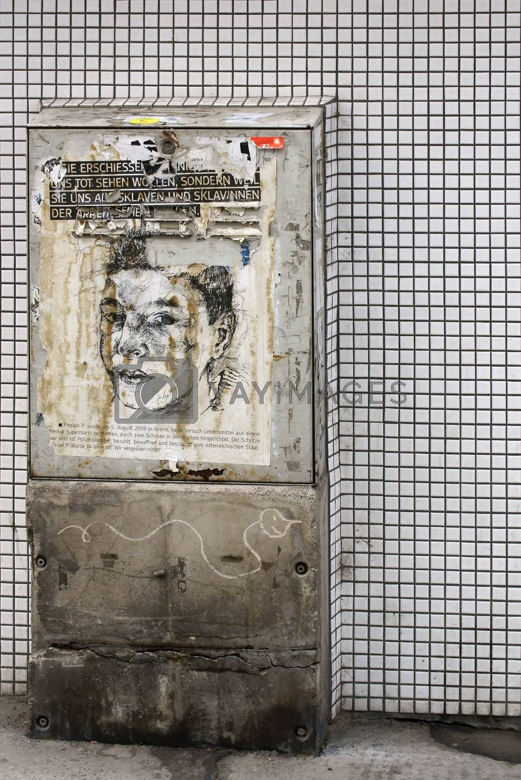 Vienna, Austria - March 30, 2014: An electric box on a tiled wall with a drawing commemorating Florian P. on March 30, 2014 in Vienna.