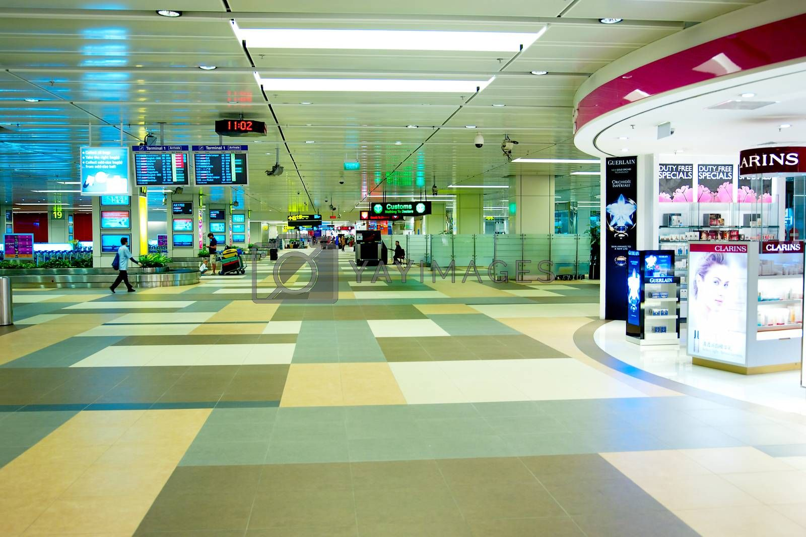 SINGAPORE - MARCH 05, 2013 : Modern interior of Changi International Airport in Singapore. Changi Airport serves more than 100 airlines operating 6,100 weekly flights