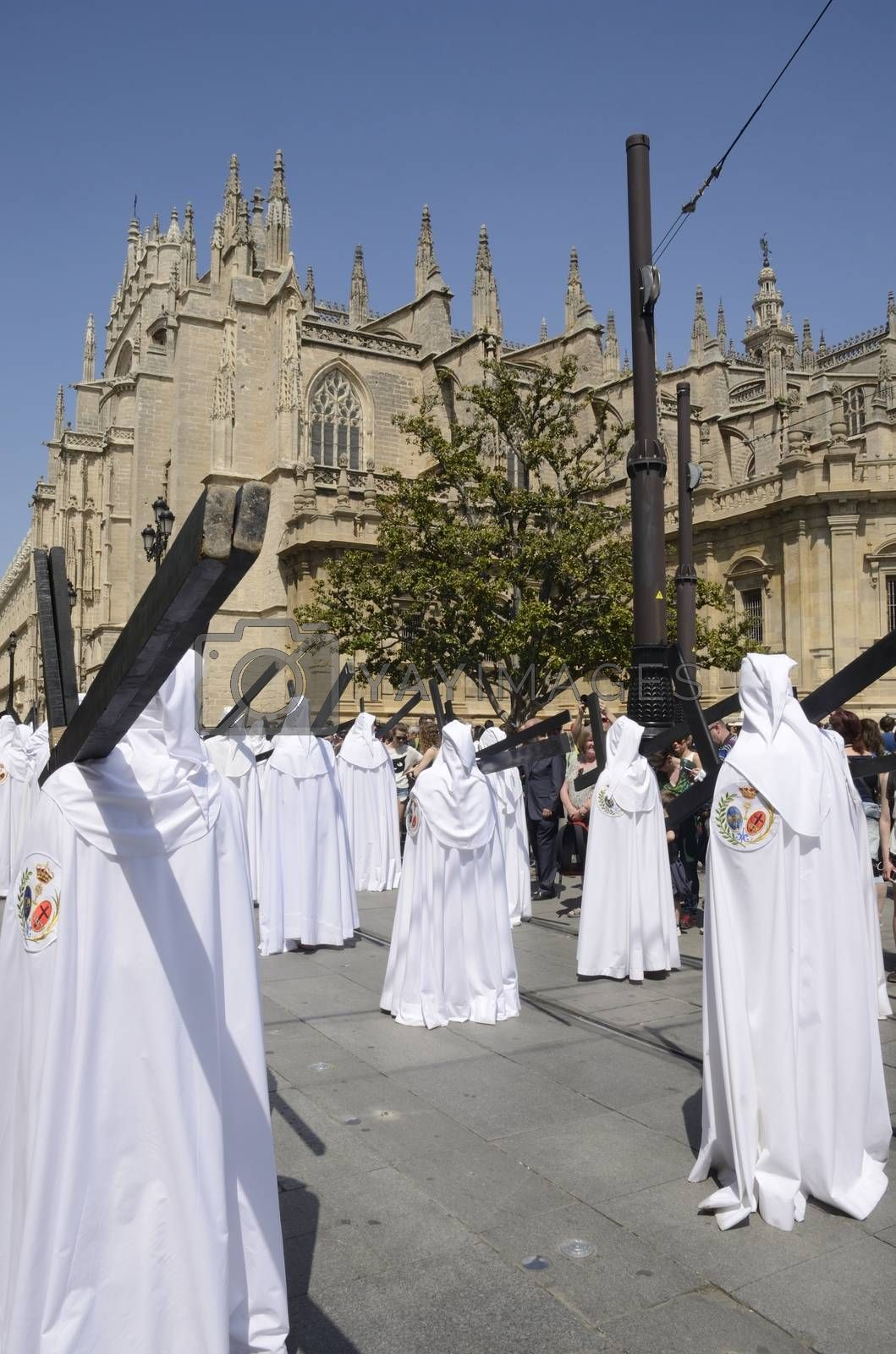Nazarenos of the Brotherhood of Peace during the holy week on Palm sunday  in Seville, Spain