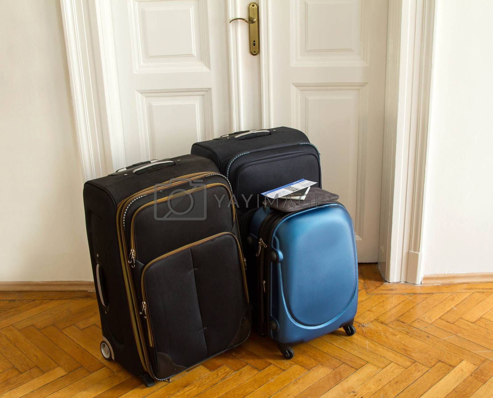 Airline ticket, passport and luggage, ready to travel