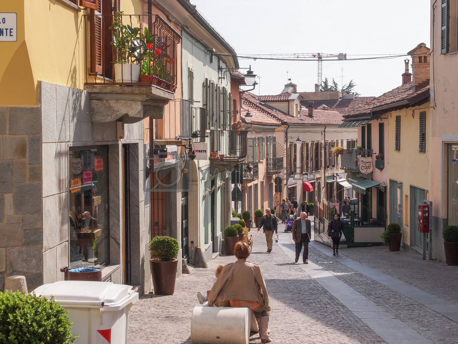 RIVOLI, ITALY - APRIL 09, 2014: People visiting the old town city centre