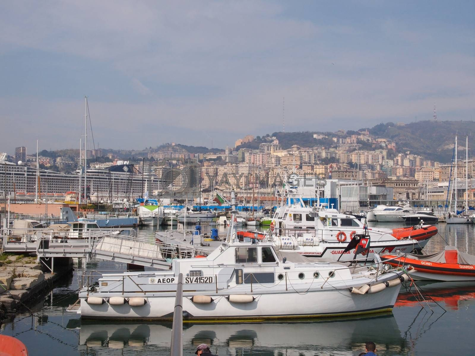 GENOA, ITALY - MARCH 16, 2014: Since the construction of the new harbour for merchant ships, the old harbour called Porto Vecchio is still in use for cruise ships and small boats