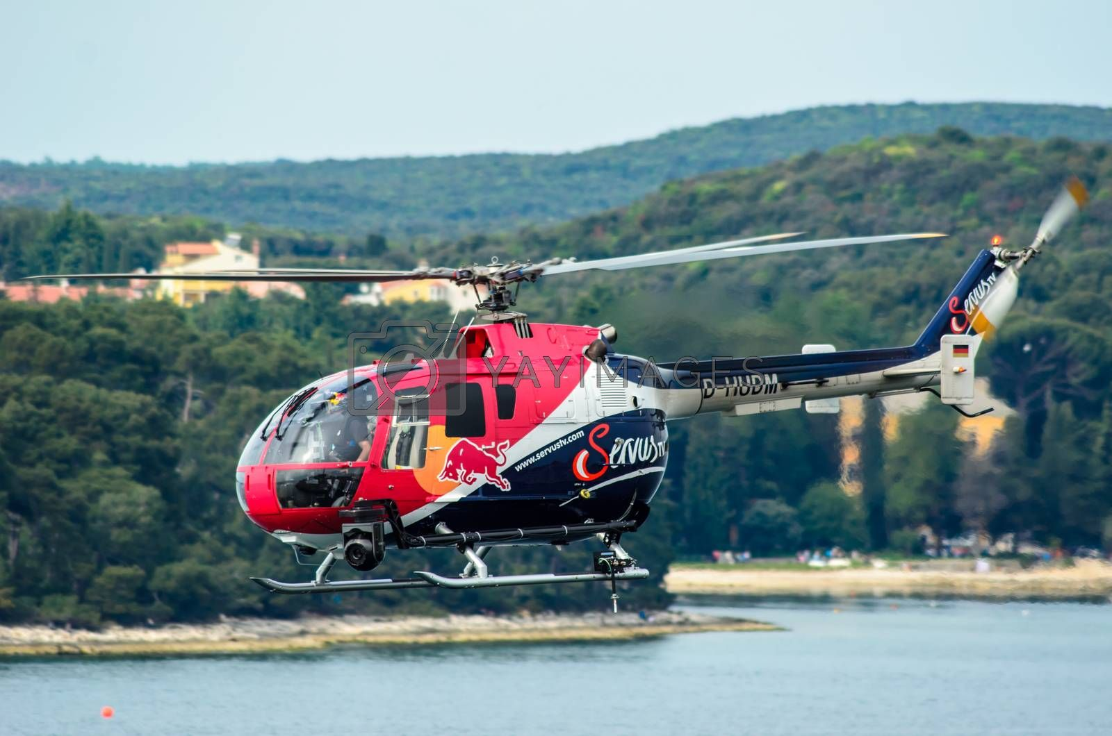 ROVINJ, CROATIA - APRIL 13 2014 safety helicopter at Red Bull Ai by vepar5
