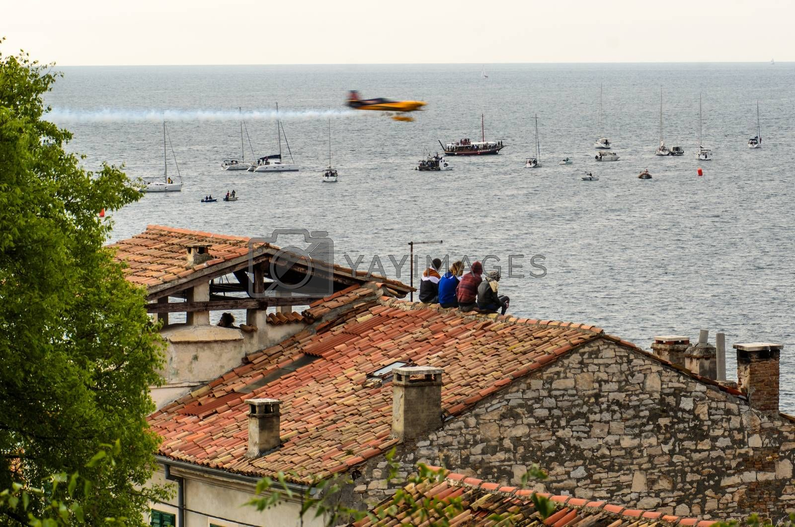 ROVINJ, CROATIA - APRIL 13 2014 spectators on roof at Red Bull A by vepar5