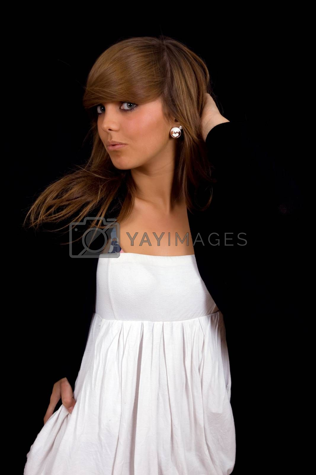 young beautiful girl portrait against black background
