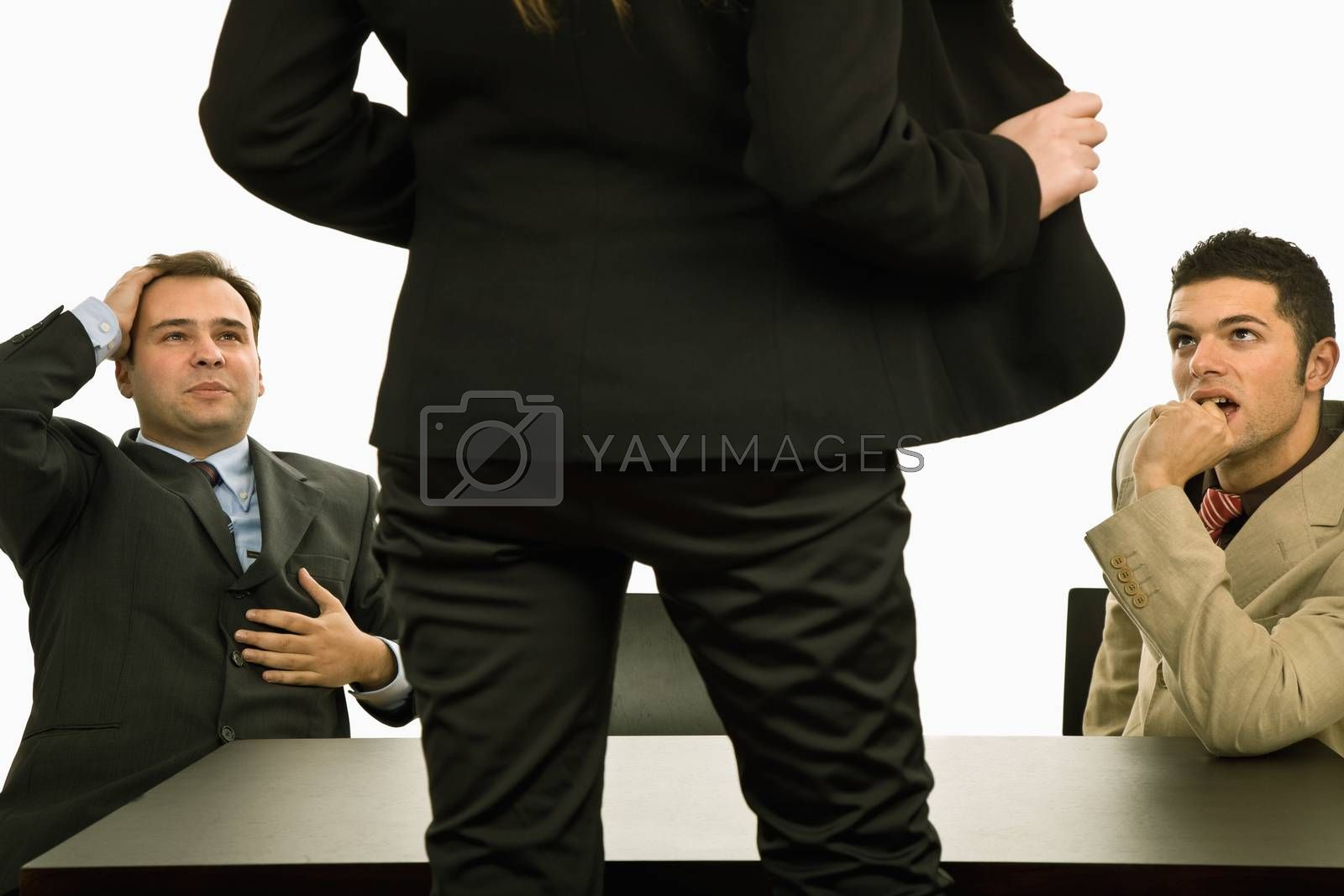 woman showing her body to two businessman