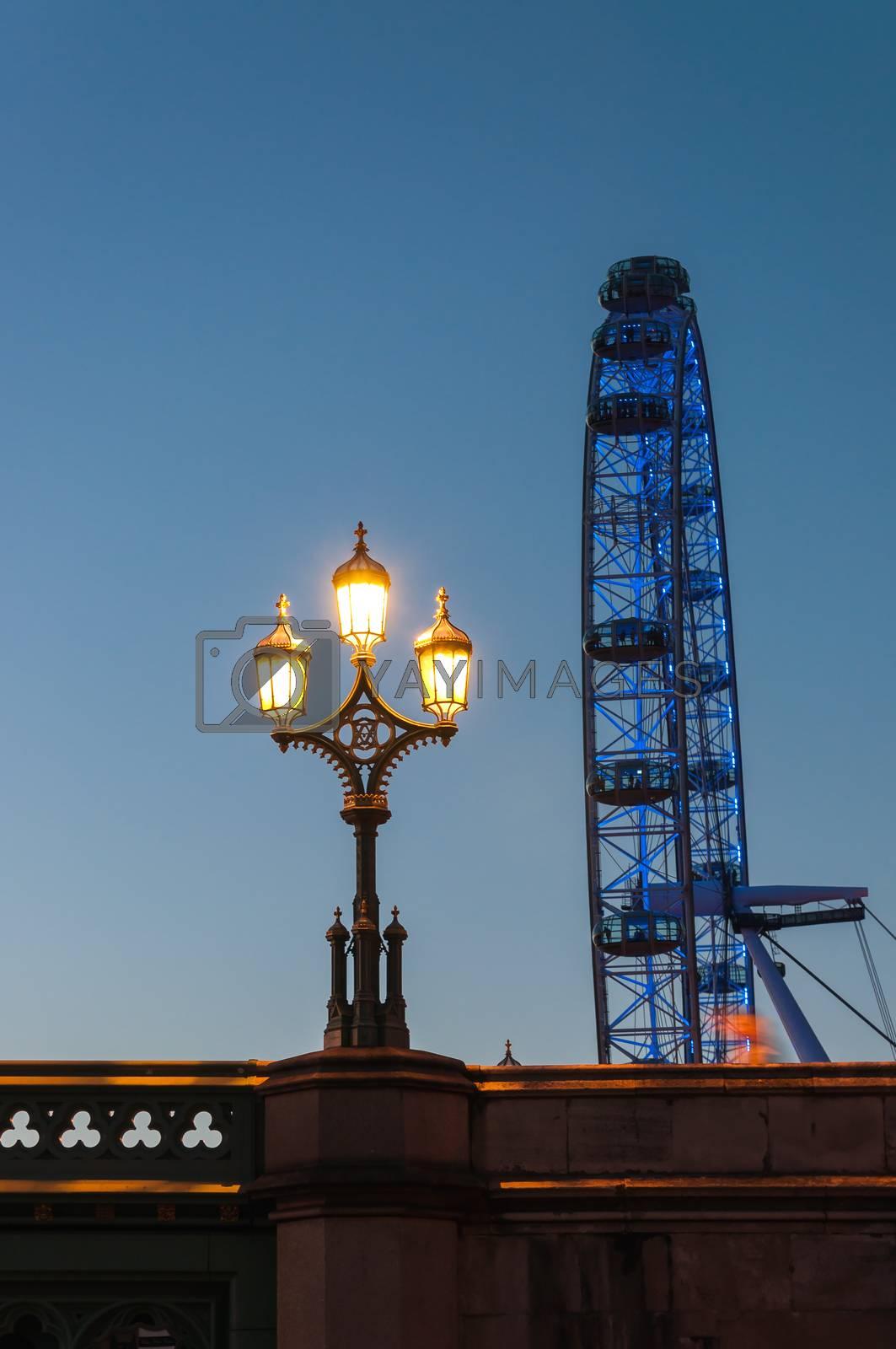 Lantern and London Eye at dusk by mkos83
