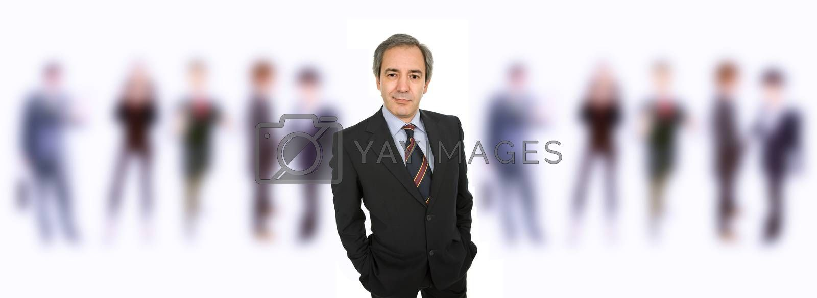mature business man portrait with some people in the back