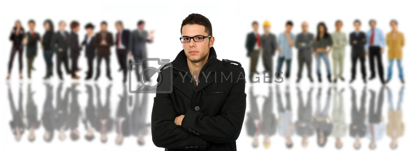 young casual man in front of a group of people