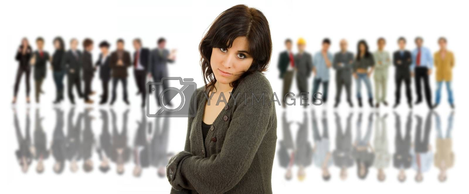 young casual woman portrait with some people in the back