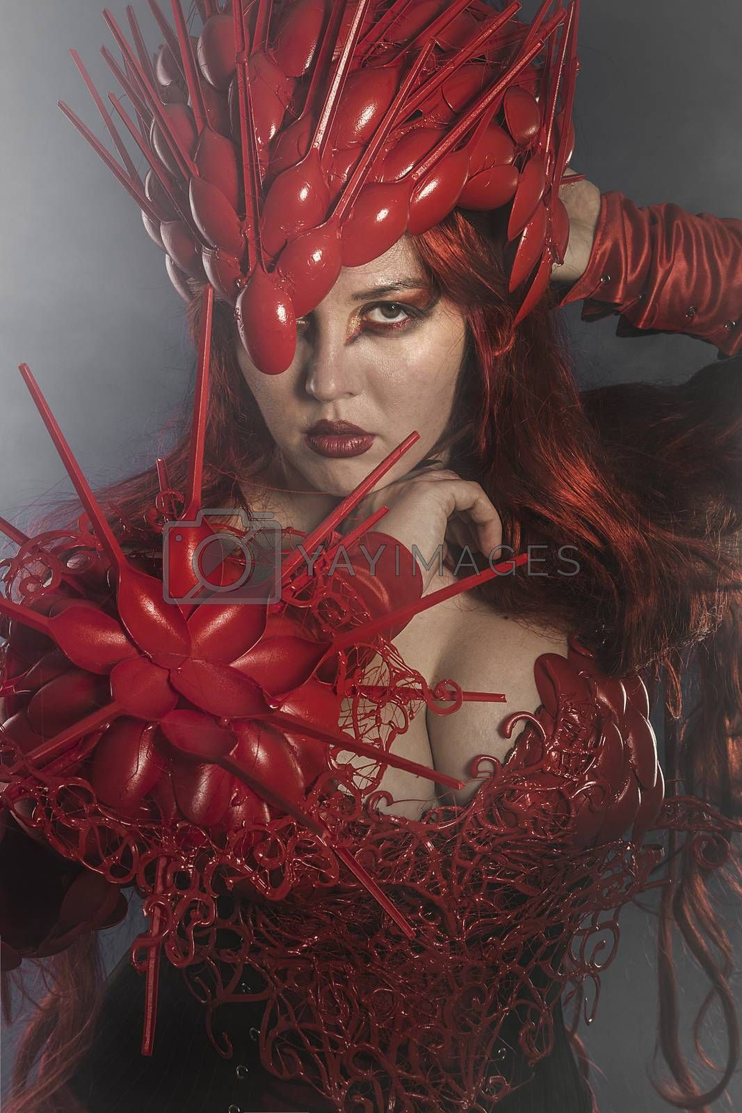 beautiful woman dressed in red armor dragon scales