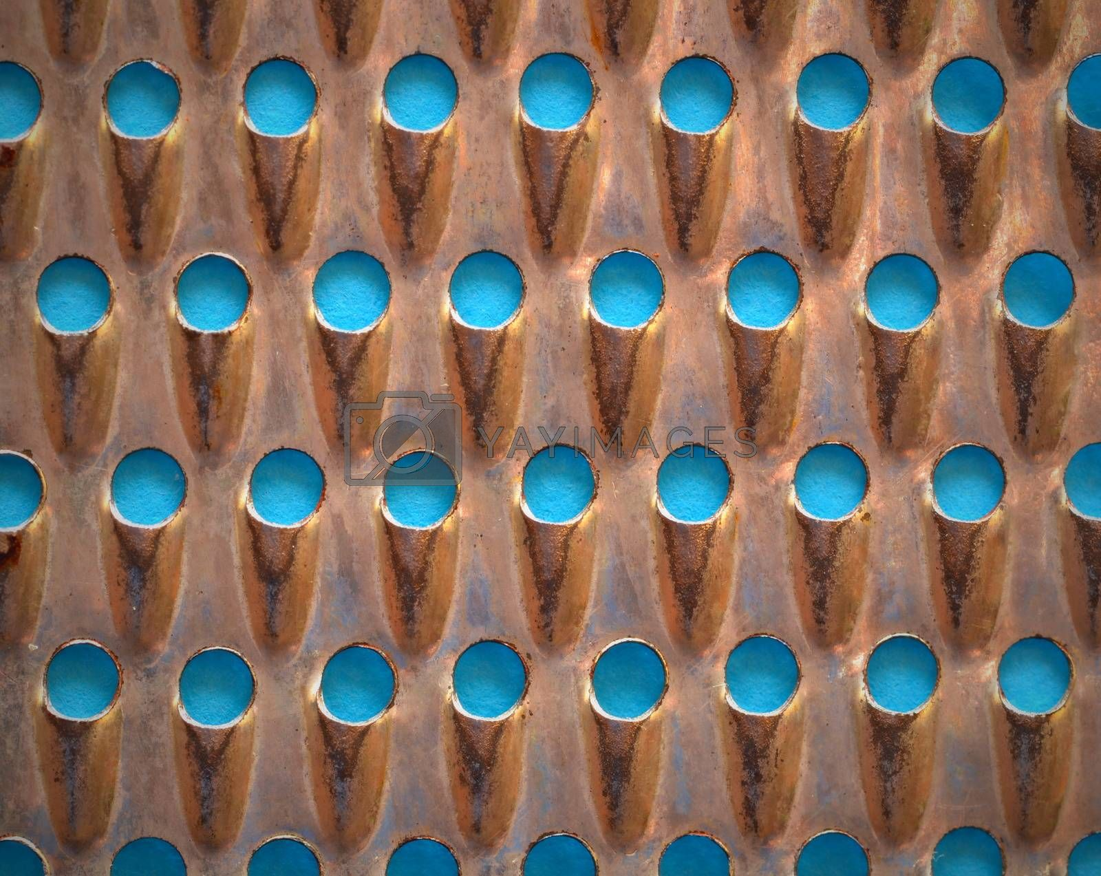 Royalty free image of Abstract background of perforated metal grater by Ahojdoma