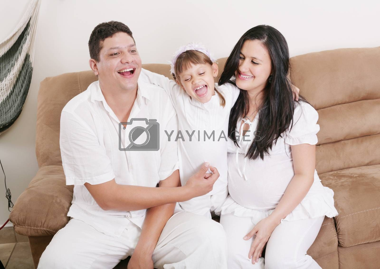 Happy American Family Playing with daughter in the living room by dacasdo