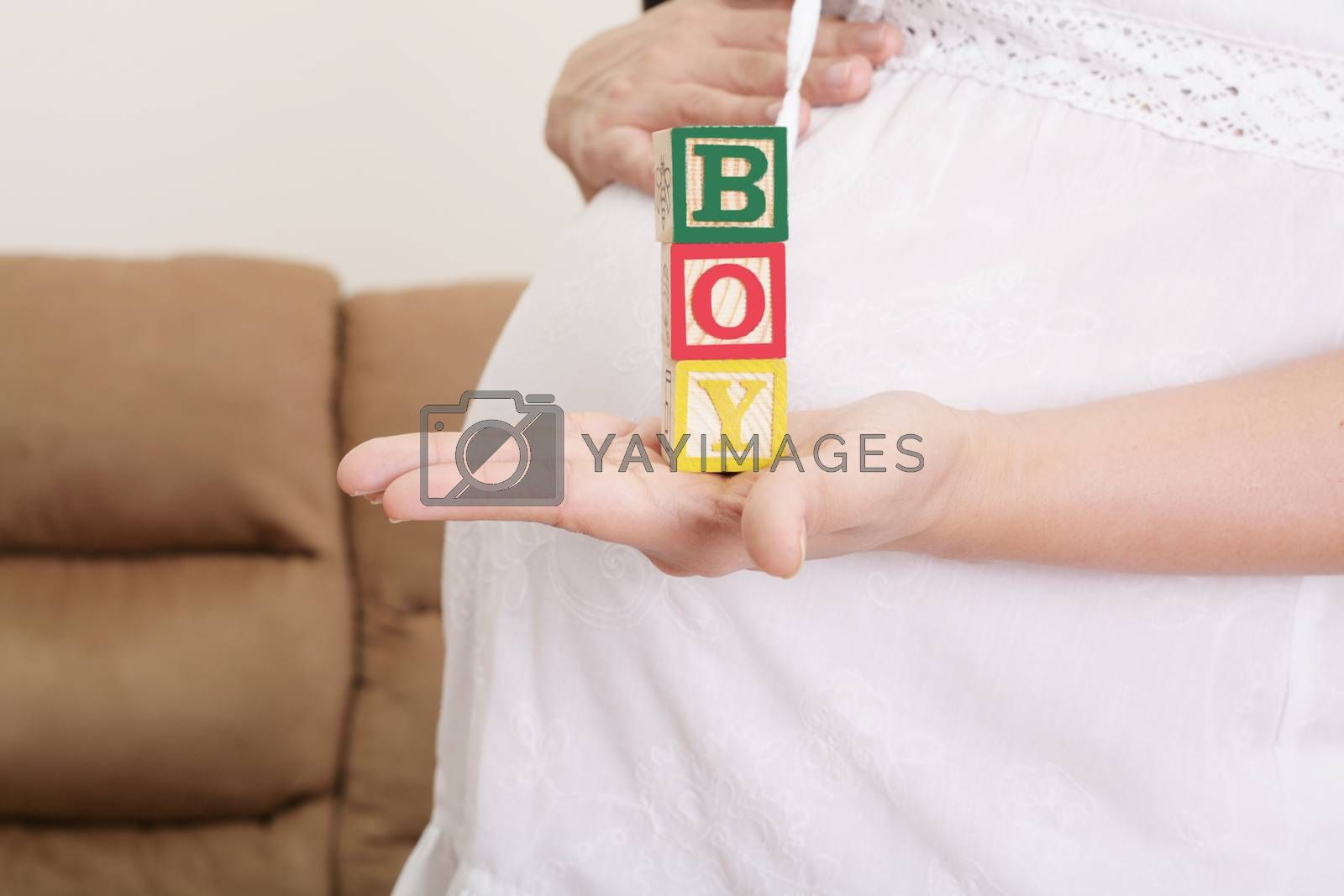 """Royalty free image of pregnant woman having the word """"boy"""" with wooden blocks written  by dacasdo"""