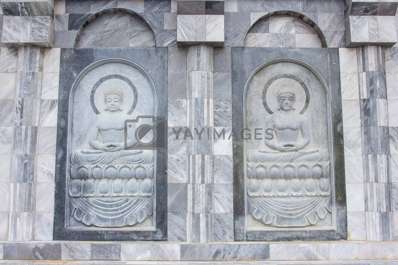 Royalty free image of The sculpture on temple wall in Thailand which open for public by kannapon