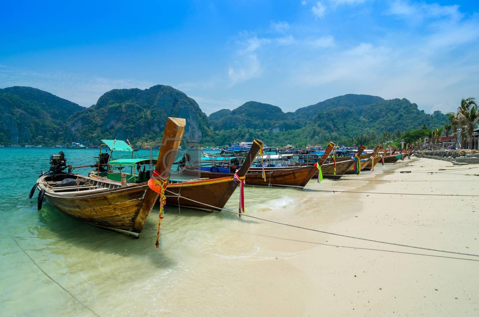 Long Tail Boats at Phi Phi Leh island by siraanamwong