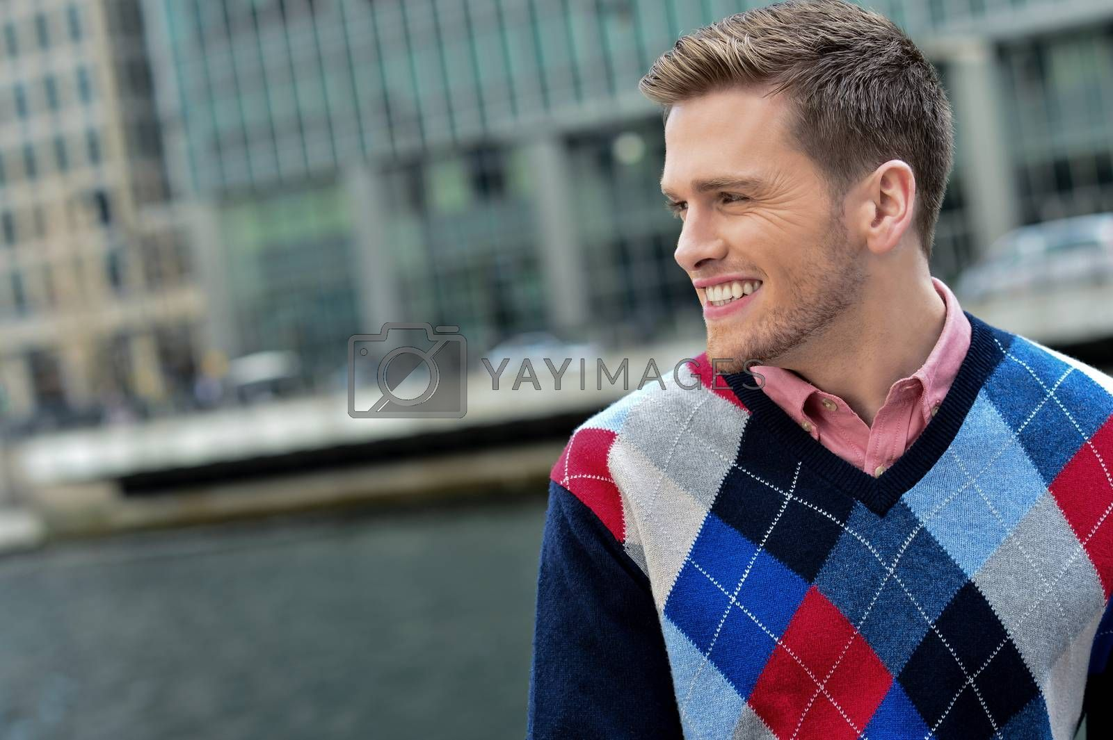 Royalty free image of Handsome young man posing at outdoors by stockyimages