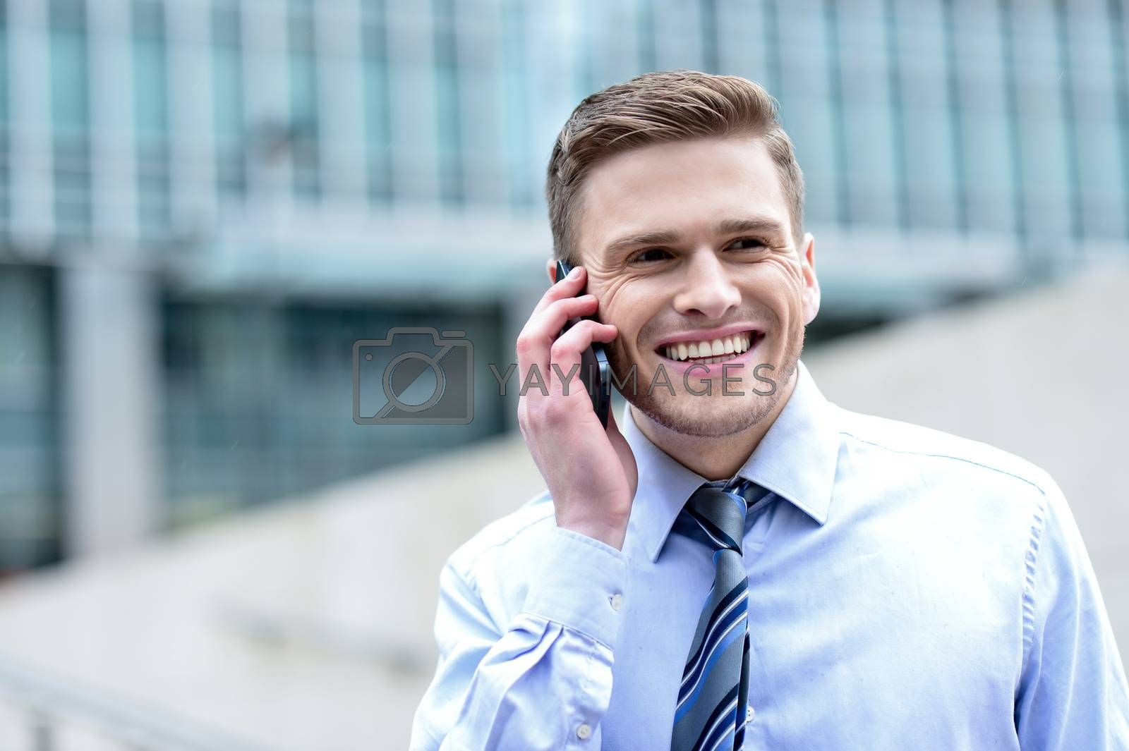 Royalty free image of Smiling businessman talking on the phone by stockyimages