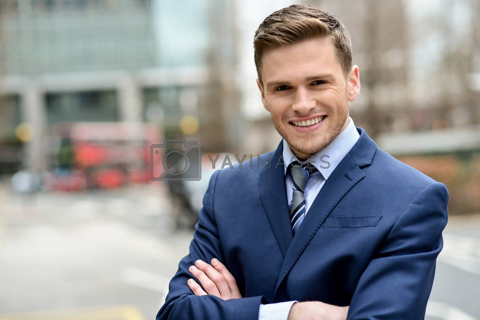 Royalty free image of Smiling businessman posing for the camera by stockyimages