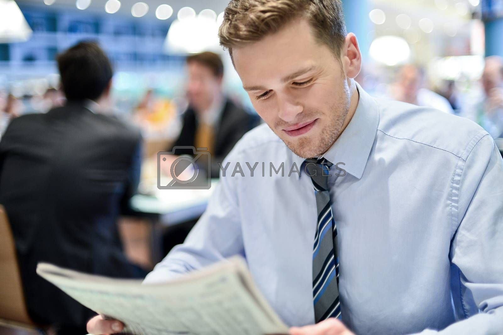 Royalty free image of Young businessman in a restaurant by stockyimages